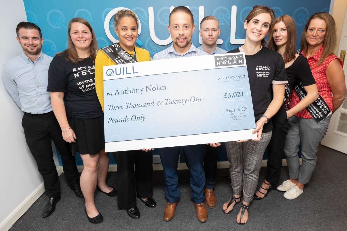 Quill employees present cheque to Anthony Nolan charity